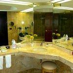Spotless marble-tiled bathroom.