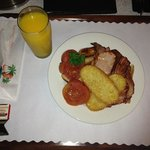 The 'Big Breakfast' served with a glass of local mandarin juice