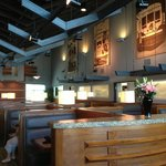 Interurban's main dining room features high ceilings, roomy booths, and interesting artwork.