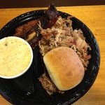 Pulled Pork with 2 ribs, jalapeño cheddar grits and yummy roll!