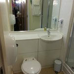 Bright clean bathroom room with walk in shower Room 302