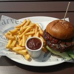 Classic beef burger with spicy sauce and jalapenos - and chips!