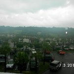 Facing inland from 4th floor of Tides building. Boardwalk sign and parking lot. Rainy morning.