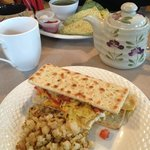 yummy breakfast flatbread with tasty hash in the foreground and a nice quesadillas in the backgr