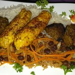 chicken and beef kabob on pilaf