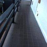 Slippery tiles - main walkway to upstair rooms