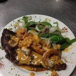 ribeye topped with grilled shrimp and lobster sauce