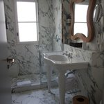 All marble bath with stand-up shower