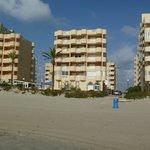 view of apt block from beach
