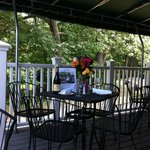 Jesse Camille's scenic deck dining overlooking babbling Hop Brook and golf course