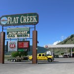 Flat Creek Inn and its fuel/gas station adjacent to busy road