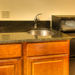 Bar sinks with fridge and microwave in king rooms