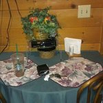 Cute dining area below flat screen