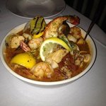 The best cioppino ever!!! that is a lobster tail swirling out the top, this bowl is deep, many m