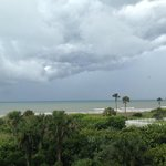 looking from room 314 toward the Cocoa Beach Pier as a thunderstorm rolls in.