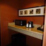 Microwave, fridge, coffee bar area of room