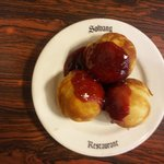 Aebleskivers with raspberry sauce, minus powdered sugar