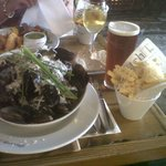 A huge plate of mussels with fries
