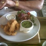 Fish goujons with mushy peas and fries