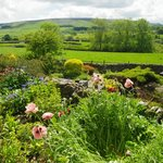 This is the view of the garden at Raines and the Yorkshire Dales in the background. Dining room