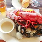 lobster bake with clams, mussels, corn-on-the-cob, and chourico sausage.