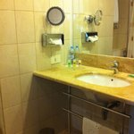 Bathroom sink and counter. The counter is small, but will fit toiletry and makeup bag.