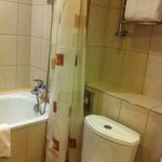 Shower/tub and toilet