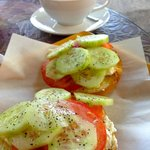 Goat Cheese and cucumber bagel with tomato