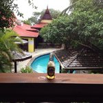 """""""Relaxing on the porch of our gorgeous room with the local """"Piton Beer""""!"""