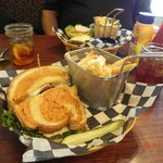 Grilled chicken pannini with a basket of fries and sweet tea