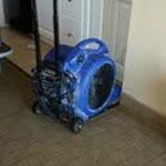 The commercial blower used to dry the saturated carpet.