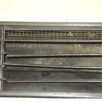 Dusty and bent vents on nosiy air conditioner.
