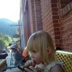 Our granddaughter enjoying a huckleberry lemonade at the Smokehouse.