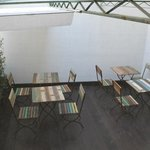 Terrace area (?communal at breakfast, private to suite during day) - overlooks closed courtyard