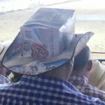 Cowboy at Prescott's World's Oldest Rodeo in hat made out of a Coors box!  Cowboy Recycling Prog