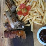 pork ribs with french fries and bbq sauce