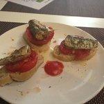 Sardines and tomatoes.