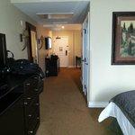 Hallway between living room and bedroom, doors to bathroom