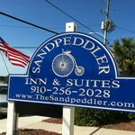 Sandpeddler sign and Old Glory
