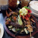 Sizzler Plate of quail, shrimp brochettes and beef.