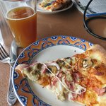 One slice of my pizza, plus beer