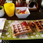 Emily's blueberry waffles with coconut rum syrup