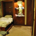 retractable extra bed in junior suite room