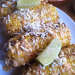 Maiz Asado - Grilled corn smeared with aioli and cotija cheese