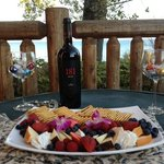 Wine with cheese, crackers, chocolate and berries we enjoyed on our deck over looking the lake.