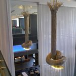 Modernist chandelier and reflection of 2 storey lobby