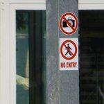Two of the many 'NO' signs found at the hotel