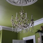 A crystal chandelier and original plaster medallion adorn the Dining Room ceiling