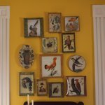 A collection of reverse decoupage adorns the front Living Room
