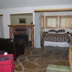 Inside looking towards fireplace and queen bed